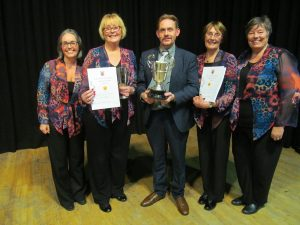 Trophy-winning Nelson Ladies' Choir conductor John Garrett with (from left) Alison Ashworth, Janet Deighton, Margaret Bainbridge and Ann Myers-Brotherston